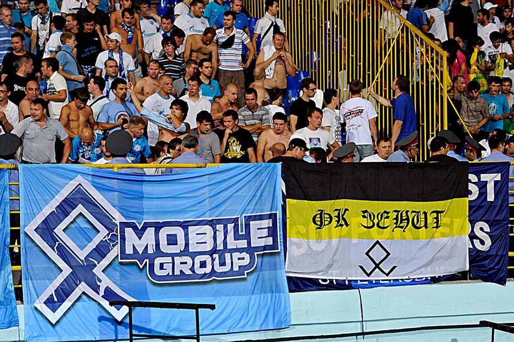 24 июля 2011 года на выездном матче с «Анжи» зенитовские фанаты вывесили баннер с руной, которая запрещена УЕФА как нацистская символика. Фанаты назвали появление руны на баннерах «данью уважения фанатов к истории родного края». Во время матча петербургские фанаты несколько раз дрались с ОМОНом и дагестанскими болельщиками. Игра останавливалась на несколько минут, но матч все-таки был доигран. В итоге «Зенит» не подвергся санкциям, в то время как «Анжи» вынужден был провести два матча на нейтральном поле и выплатить штраф в 600 тысяч рублей.