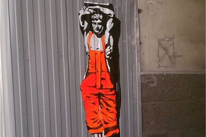 В Петербурге появилось граффити с Атлантом в образе разнорабочего