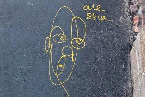Это арт-группа alesha. Вы точно видели на тротуарах Петербурга желтые портреты, нарисованные ими одной линией